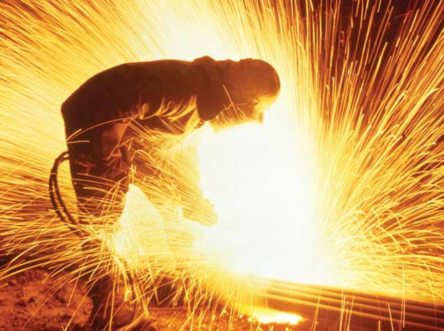Welding steel with sparks flying